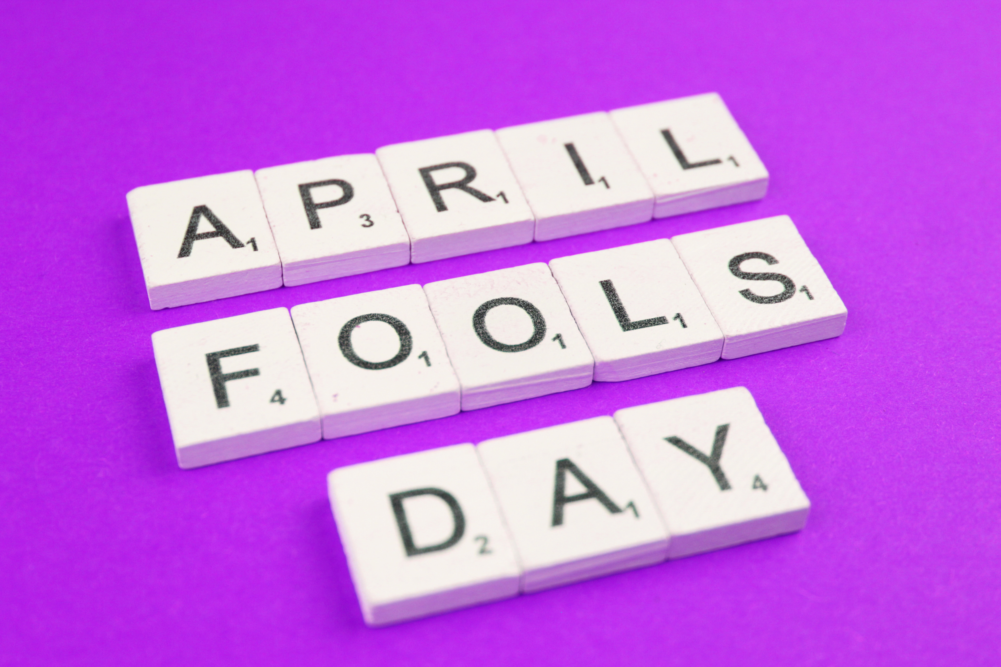 april-fools-day-scrabble-letters-word-on-a-purple--72EA563
