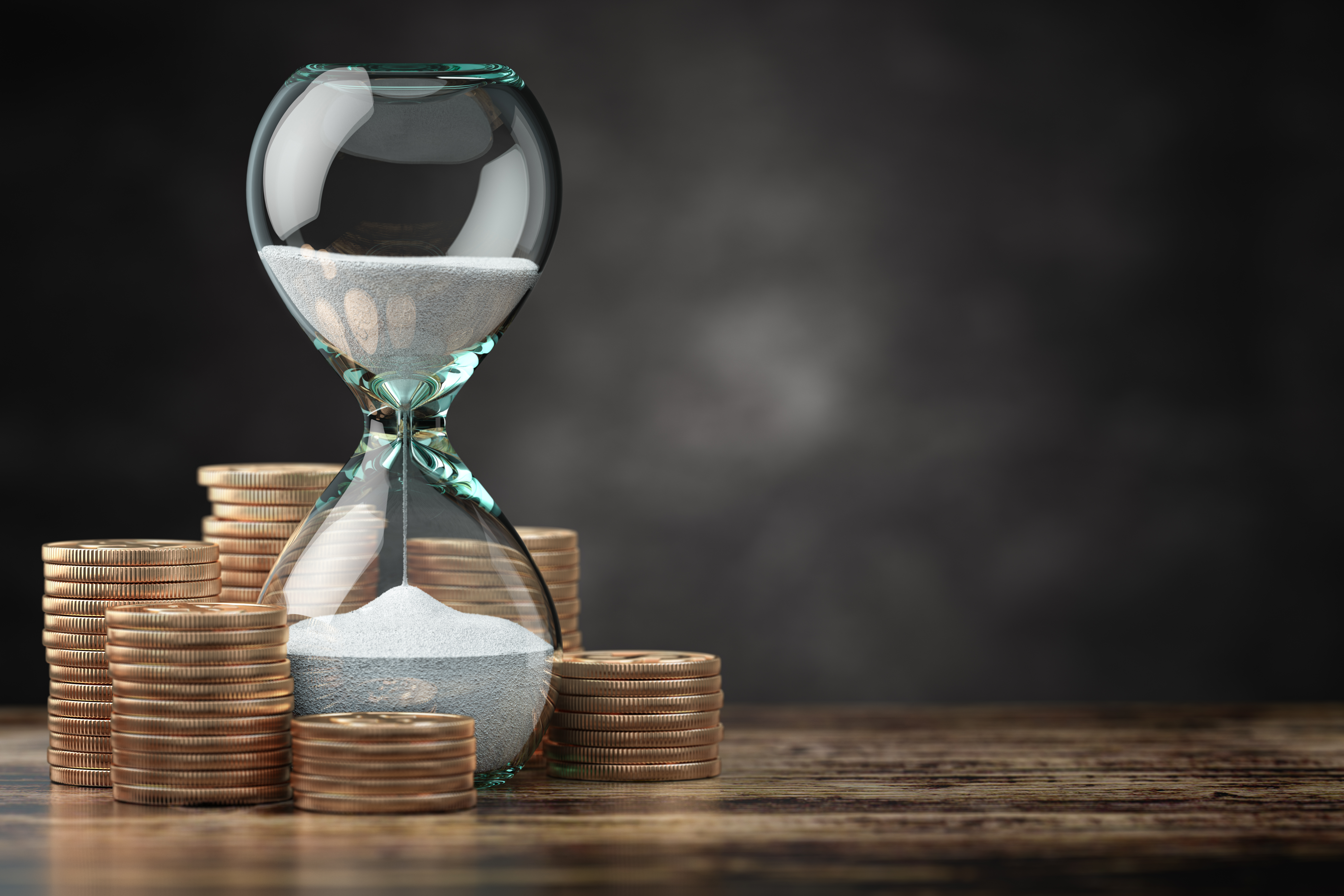 golden-coins-and-hourglass-clock-return-on-investm-MM5JG2C