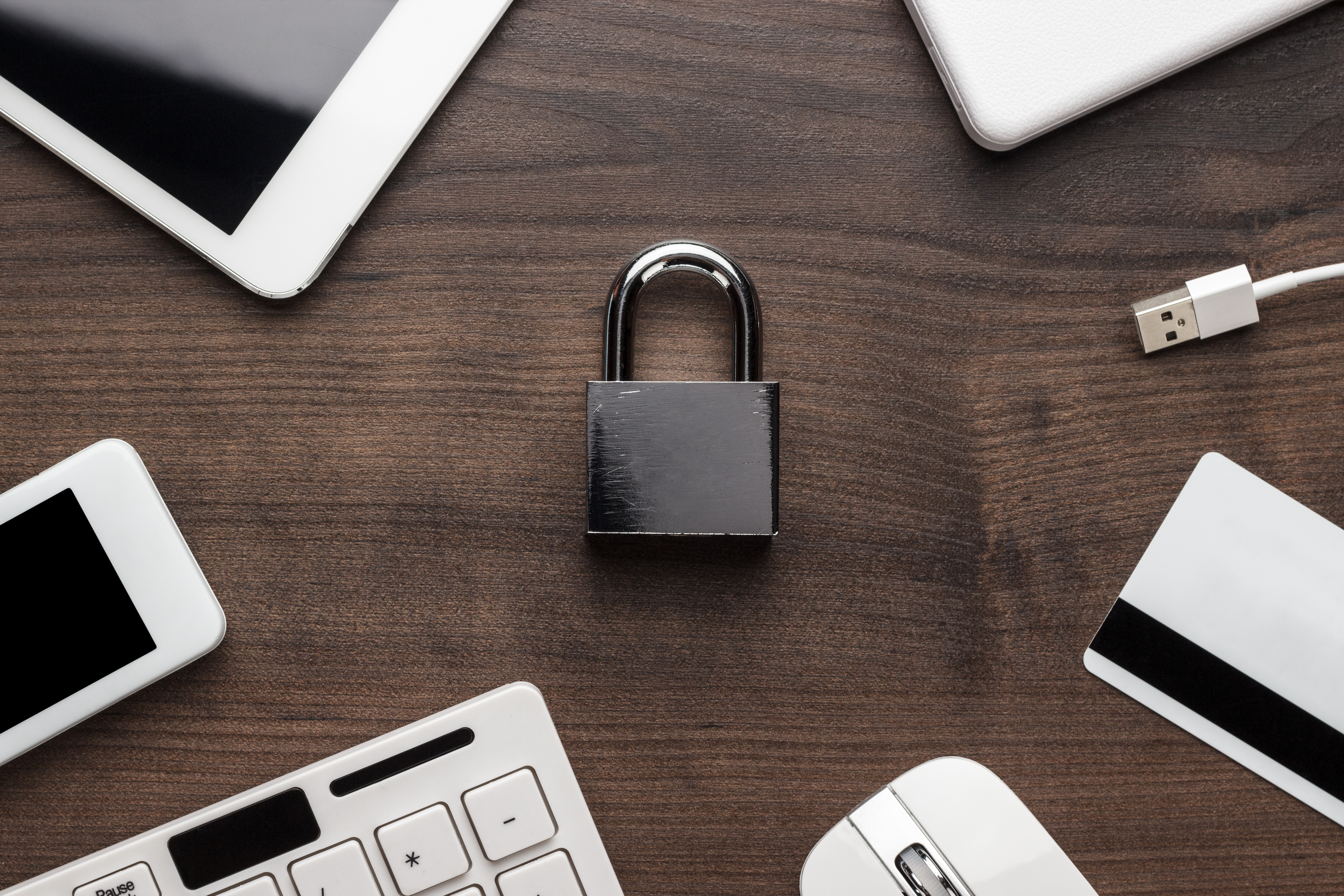 padlock-and-different-gadgets-on-the-wooden-office-PCCFMTE