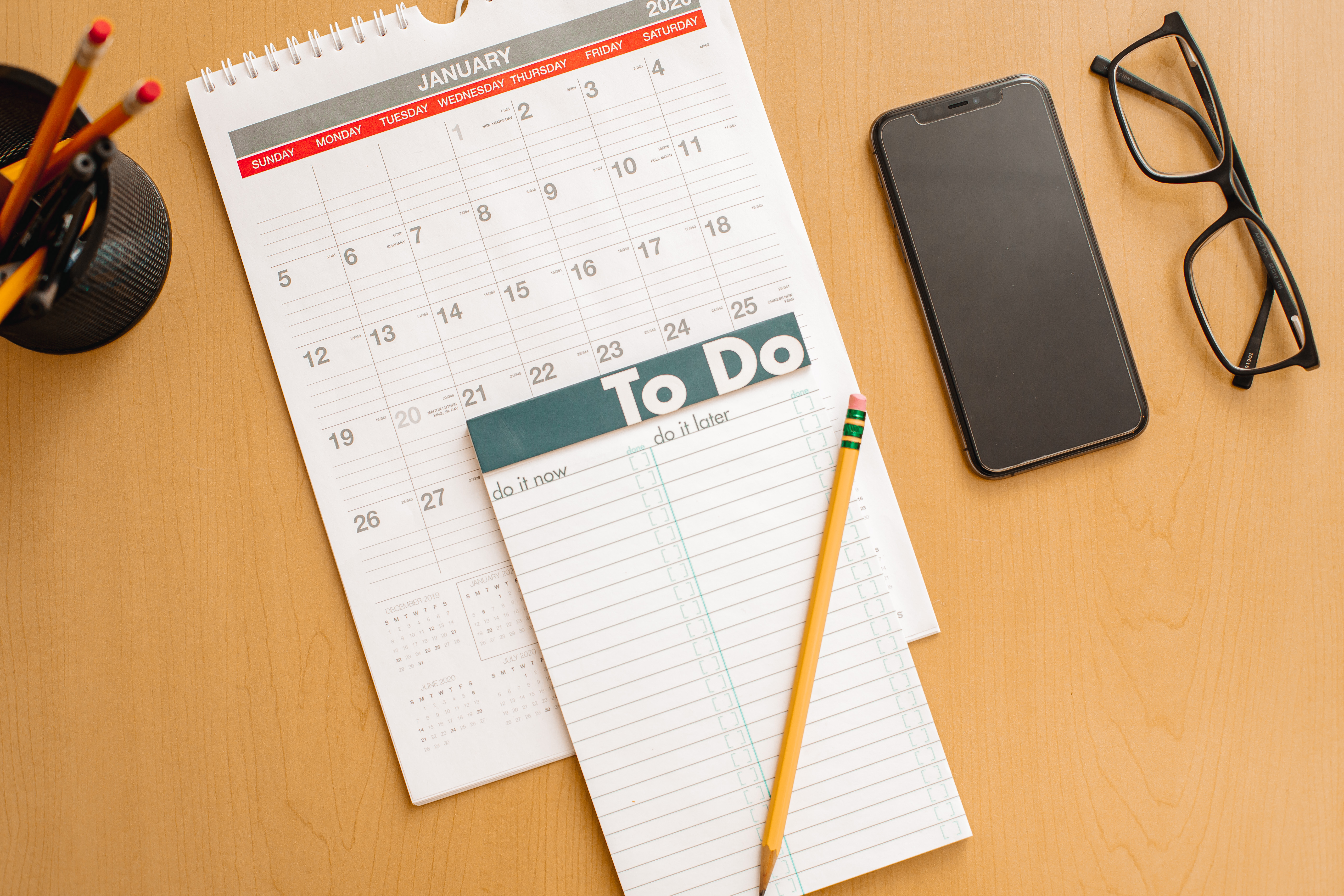todo-book-on-top-of-a-calendar-showing-the-month-o-TYBTWC4